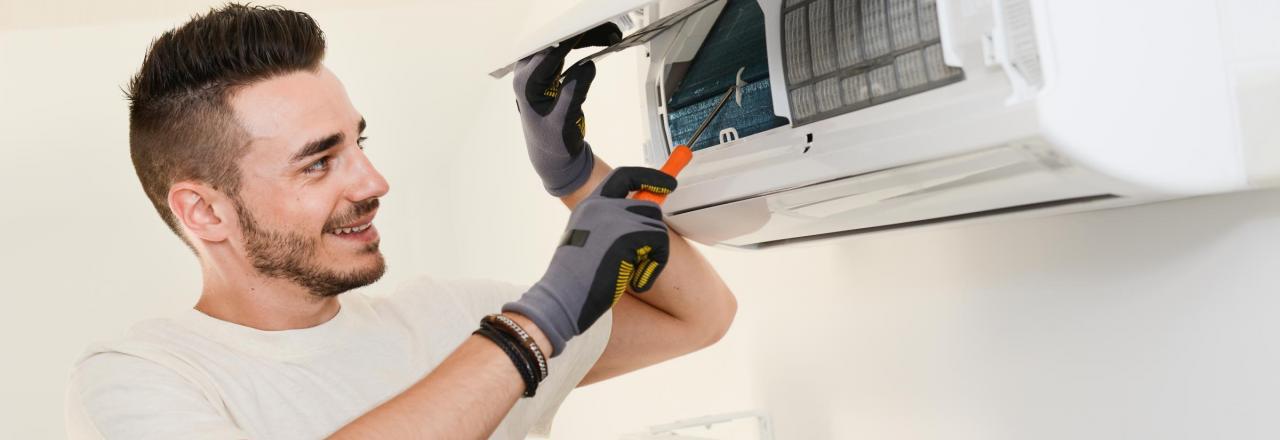 technician installing mini split heat pump inside home